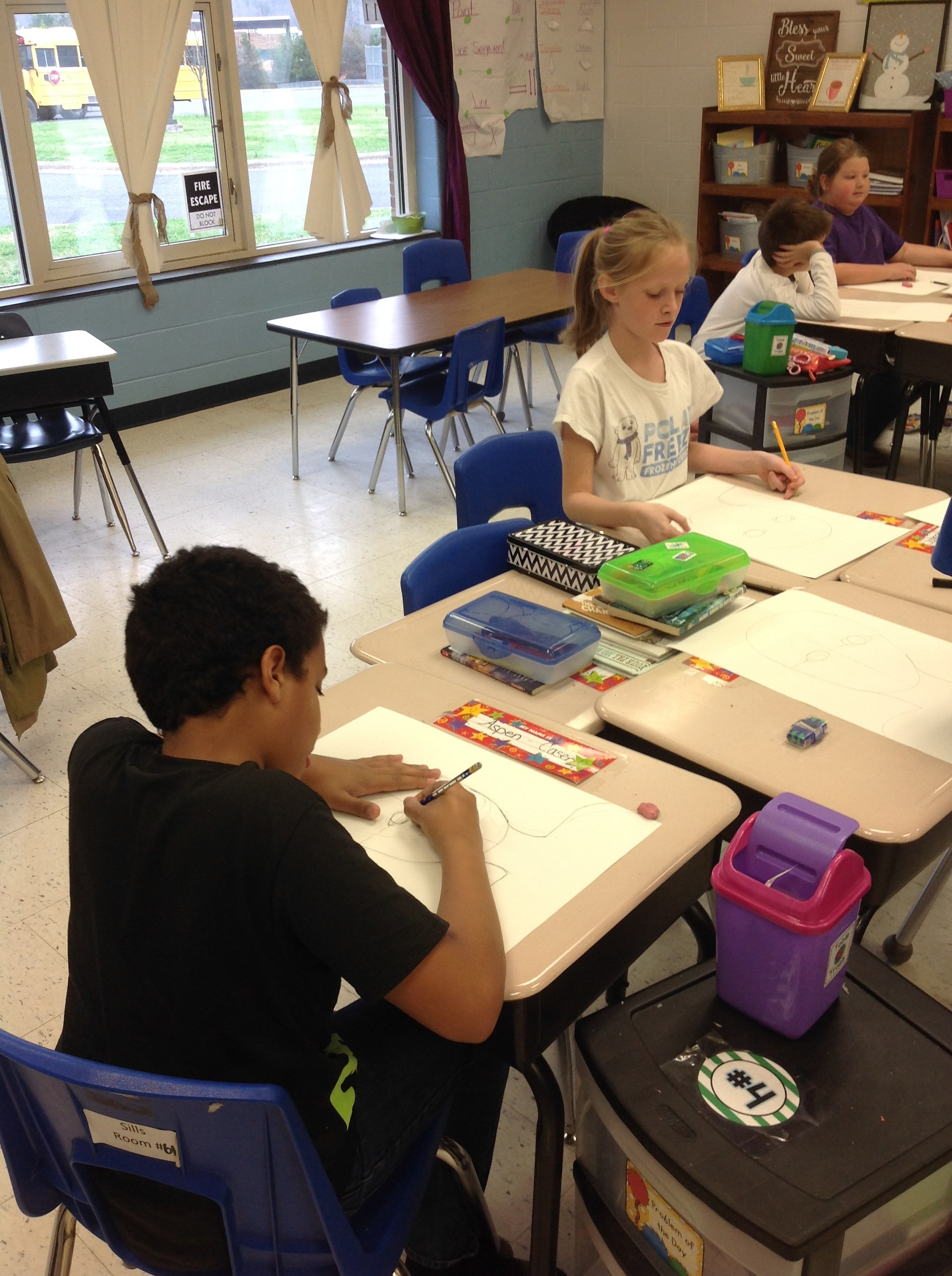 Aspen's group working on their portraits.