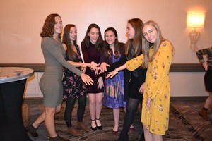 A group of girls from the class of 2019 show off their class rings.