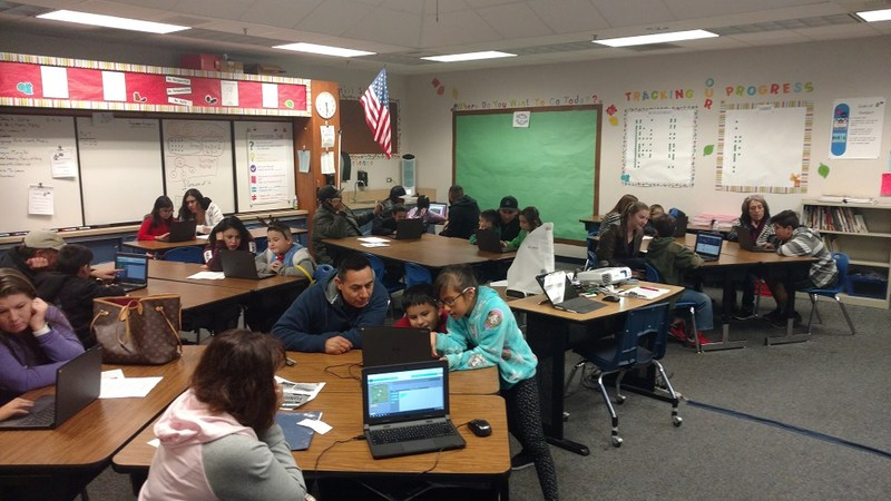 Harmony students and parents at Parent Night learning about computer programming.