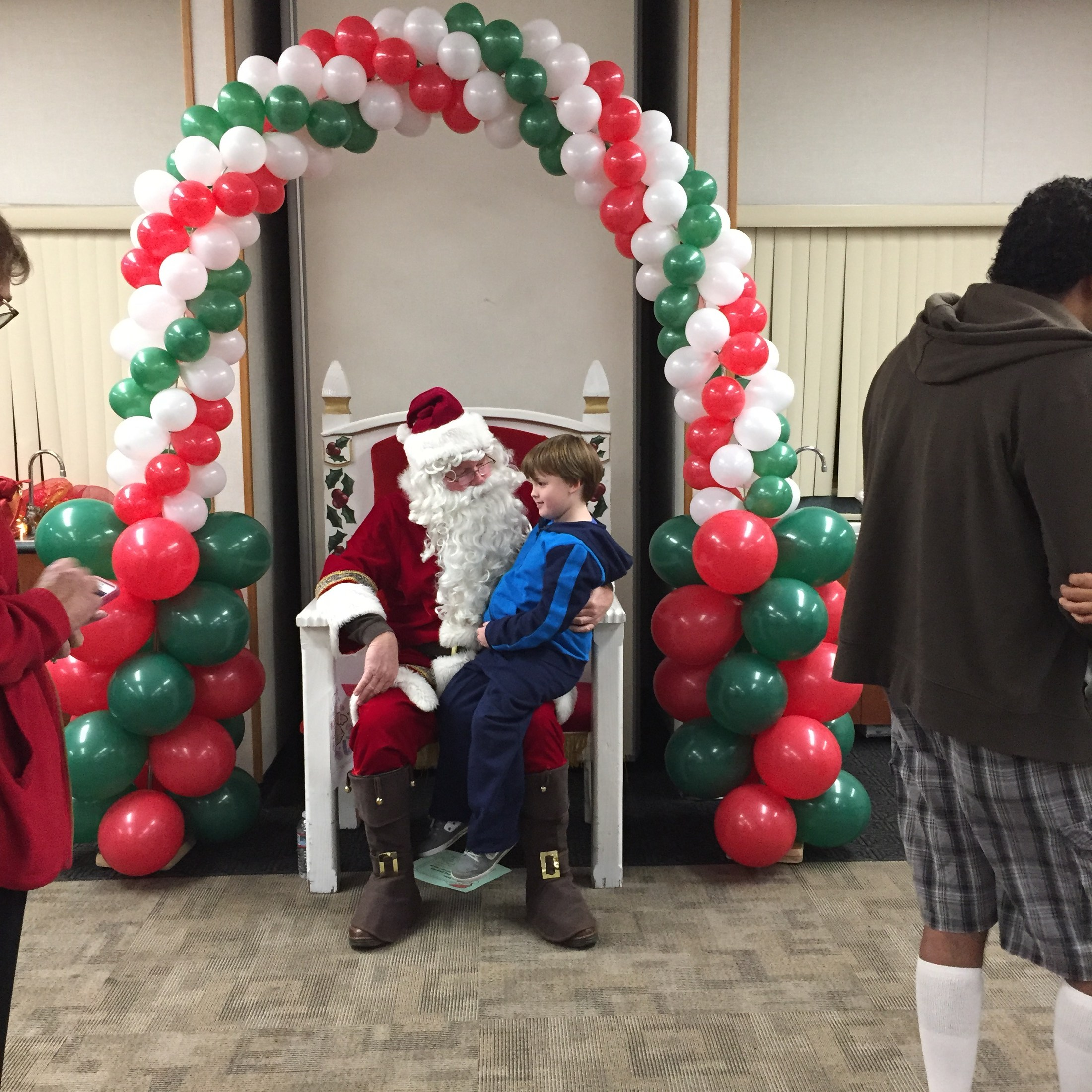 Visiting with Santa at the second annual Evening with Santa event.