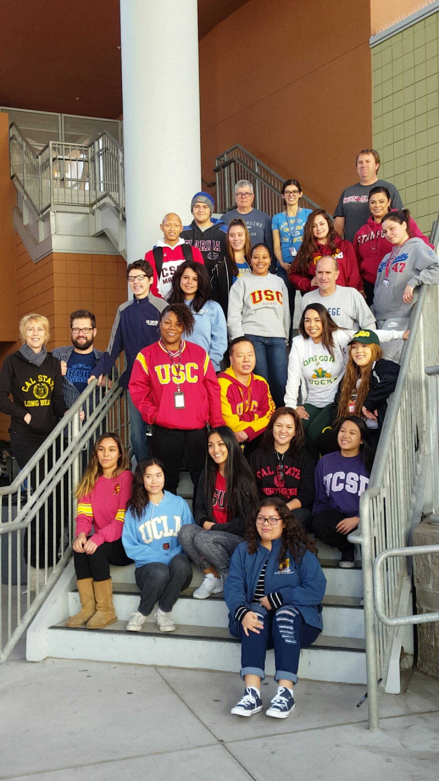 VAAS Faculty and students wearing college gear