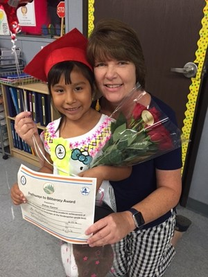 Ms. Houlihan with one of her award winning students.