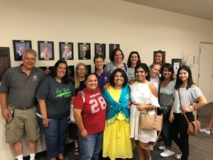Maria Martinez with staff and family.
