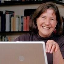 Pari Noskin Taichert smiling with laptop
