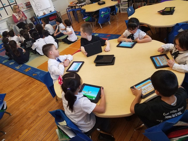Santiago students work on their tablets