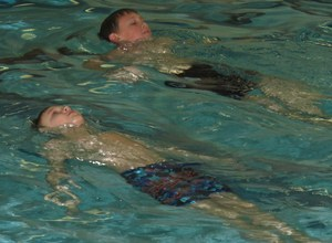 Elementary students learn to float in the pool as part of a four-week swimming lesson as part of their physical education classes.