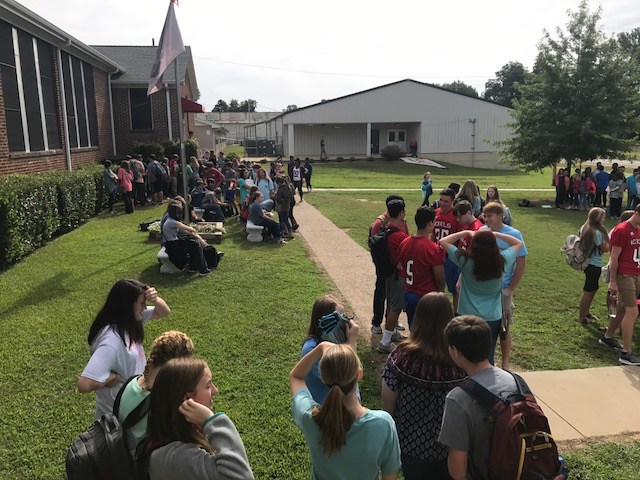 students at break on front lawn of school