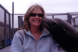 A sea lion is giving me a kiss.