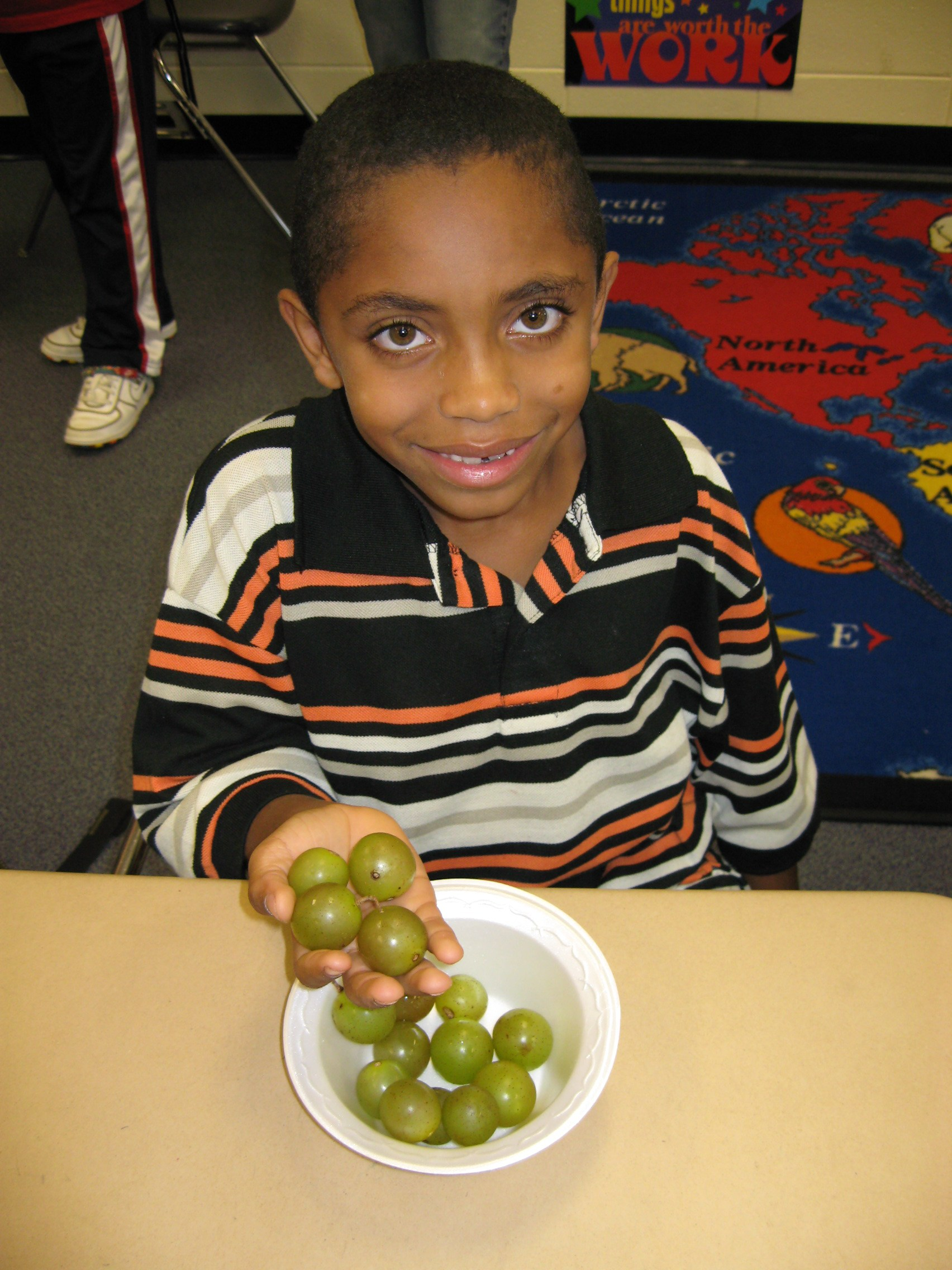 Student holding grapes
