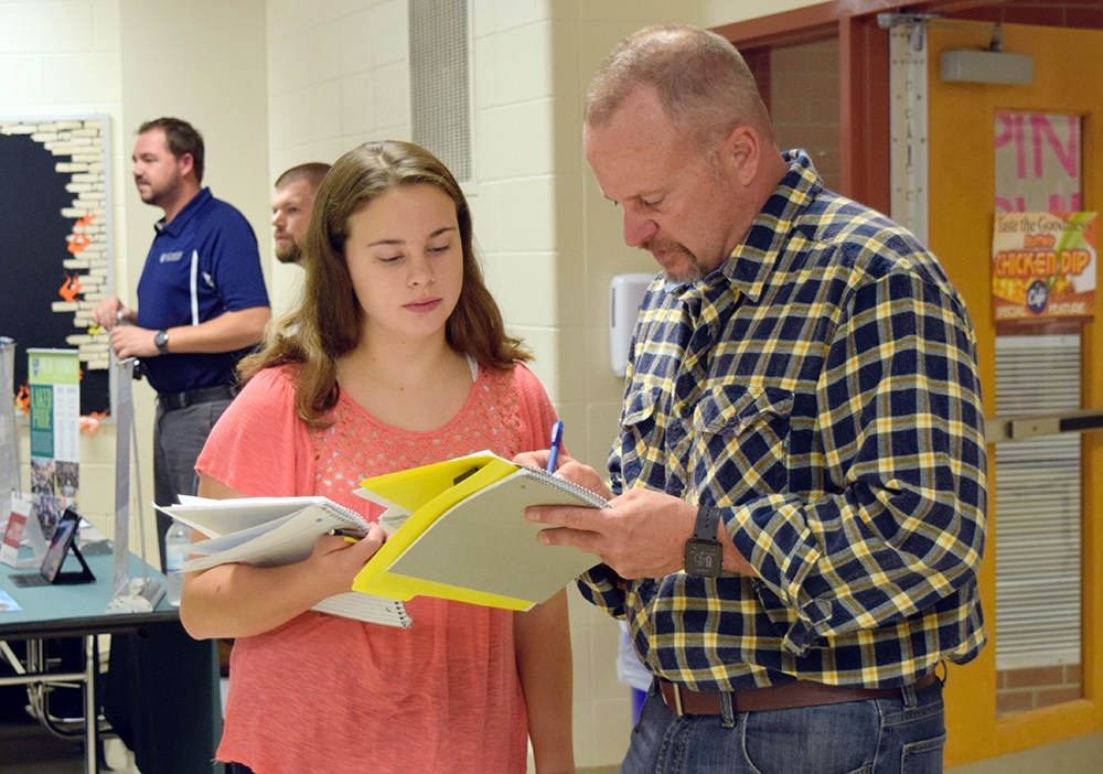 student and parent reviewing paperwork