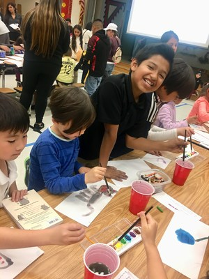 students participating in art and literacy activities