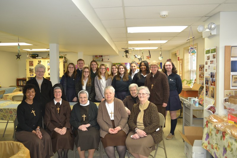 OLSH students pose with Felician Sisters after volunteering together as part of National Catholic Sisters Week.
