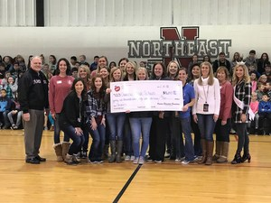 Teachers receiving large check