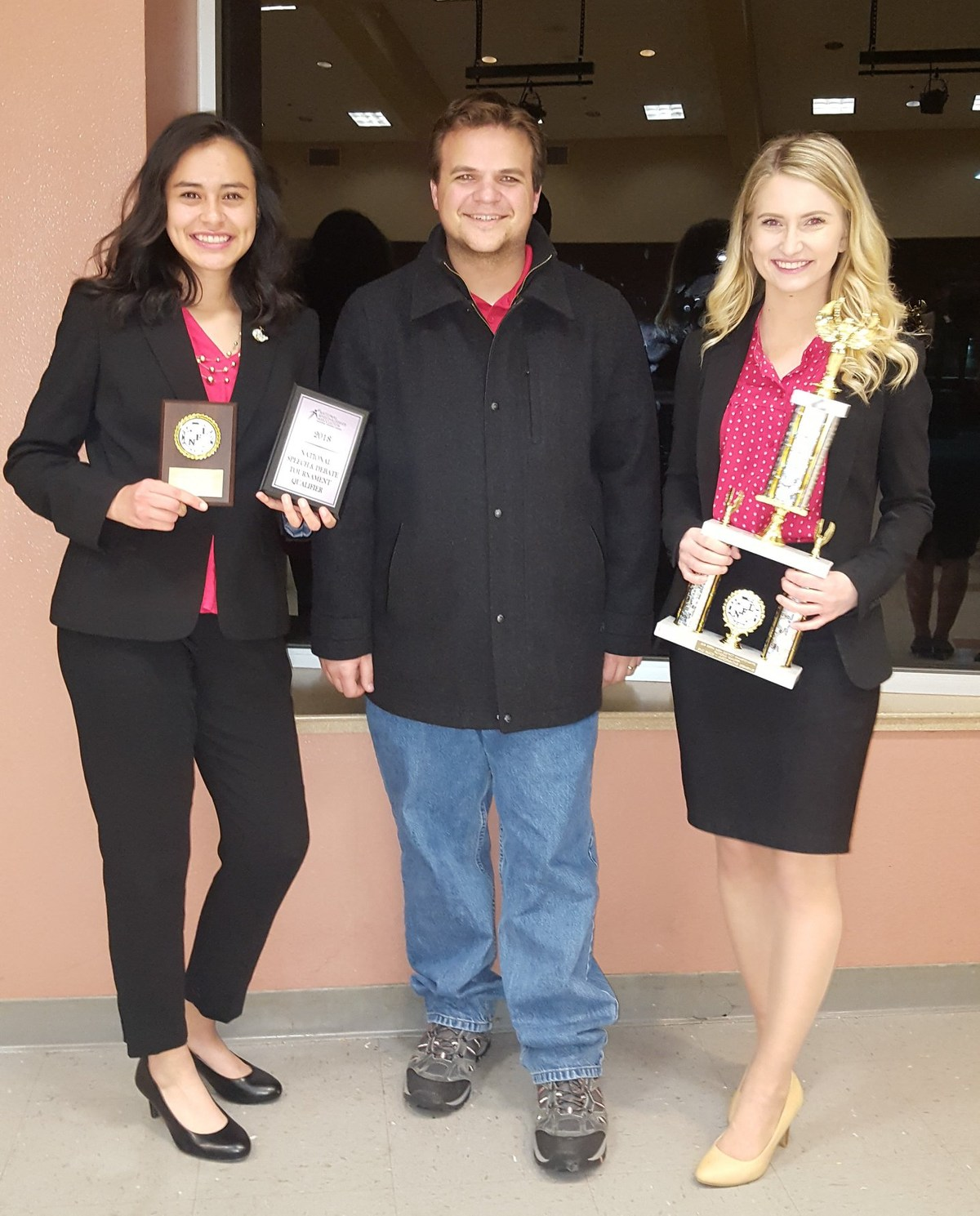 Andrea Jimenez and Caitlin Herring pictured with coach Bill Turner