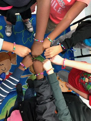 JL Lomax students show off their bracelets!
