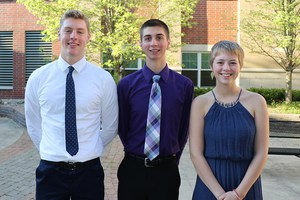 Co salutatorians Josh David, left, and Brenna Larkey, right. The Valedictorian is Nate Piersma (center.)