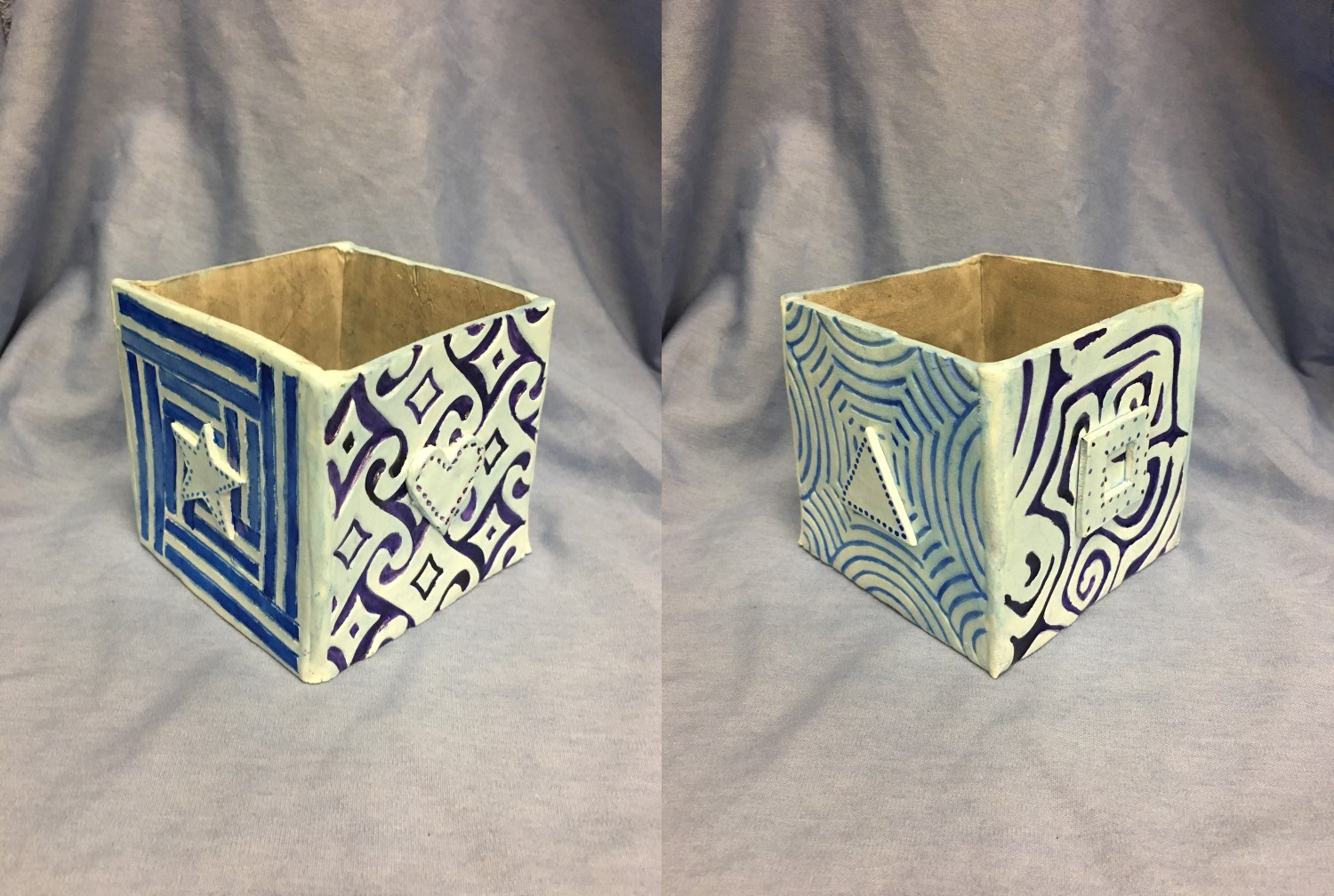 Clay box with designs painted in blue and white
