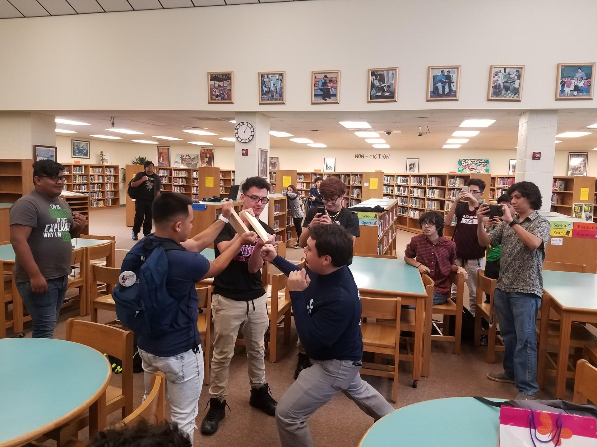 Mr. Ramirez is shown breaking a board.