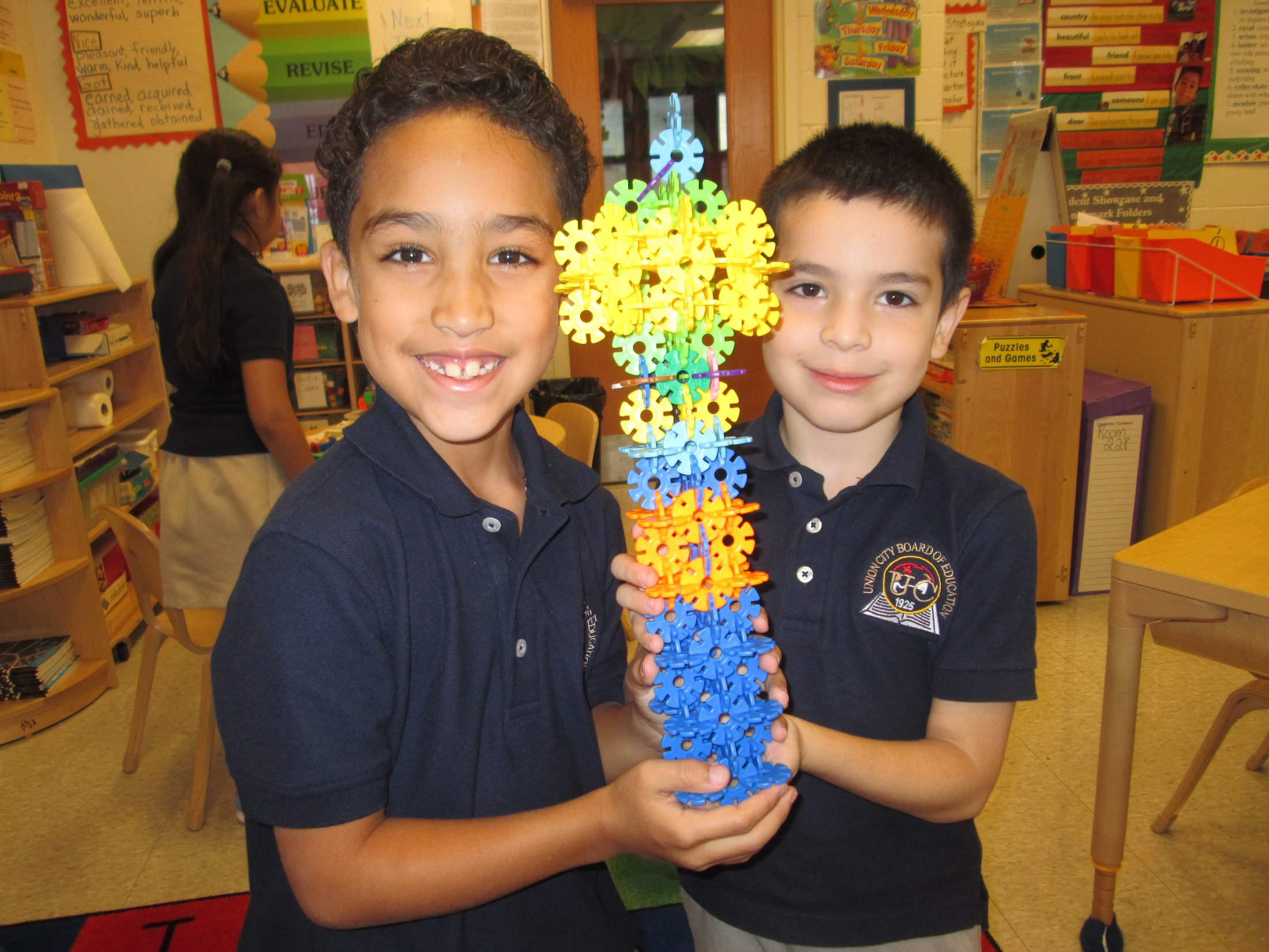 two boys showing off their sculpture