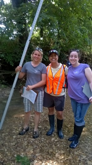 Teachers, wading boots, creek bed, STEM training