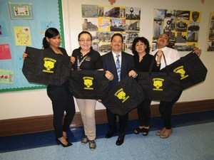my celebrano and his office staff handing out the totes