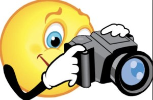 Image of smiley face with camera