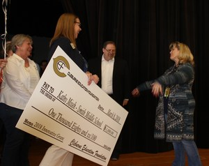 Smith Middle School teacher Kathy Misek surprised with news she has received a CEF Innovative Grant Award.