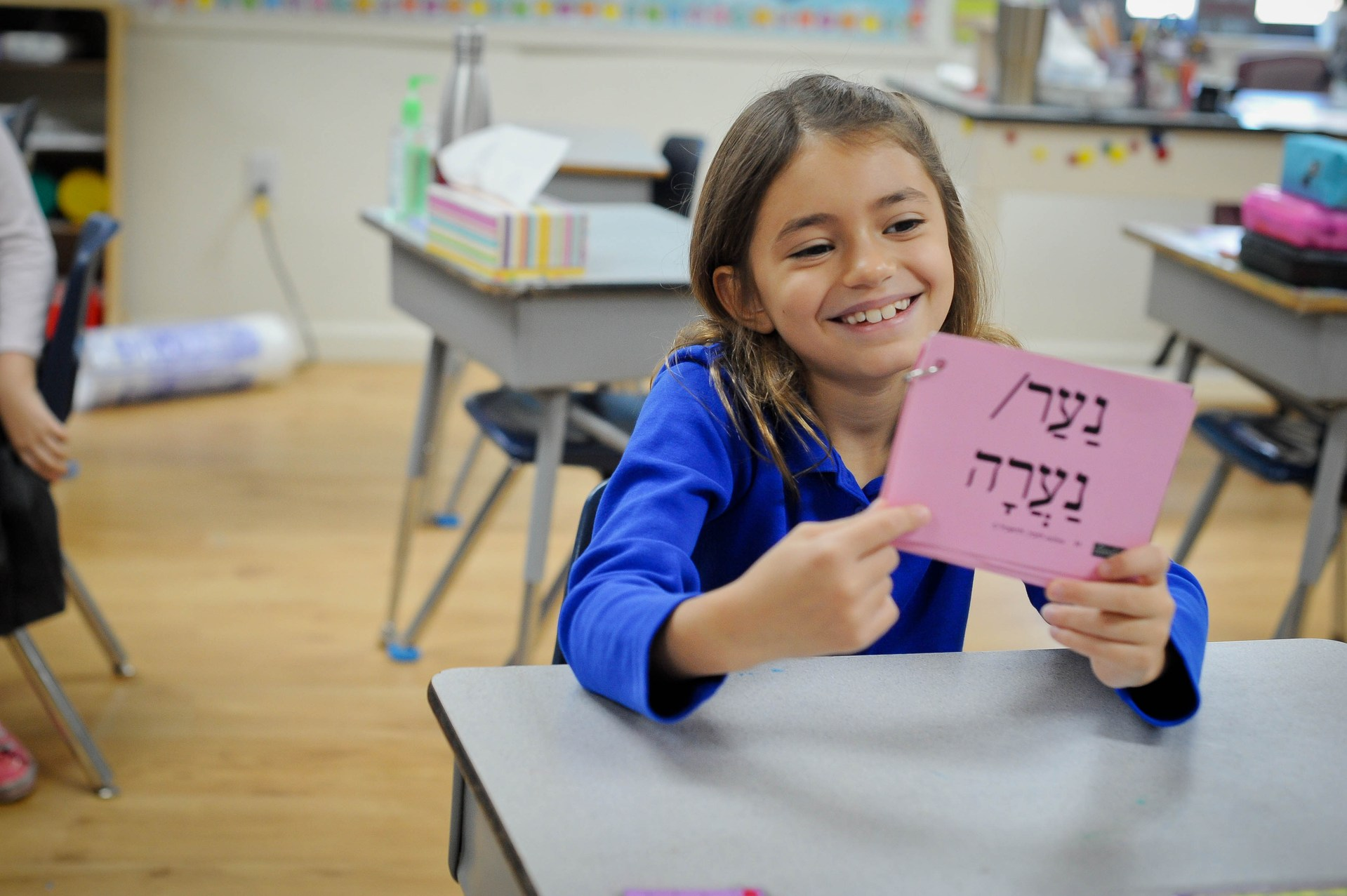 girl learning hebrew words