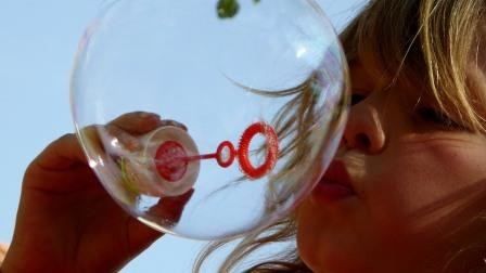 Camper blowing bubbles.