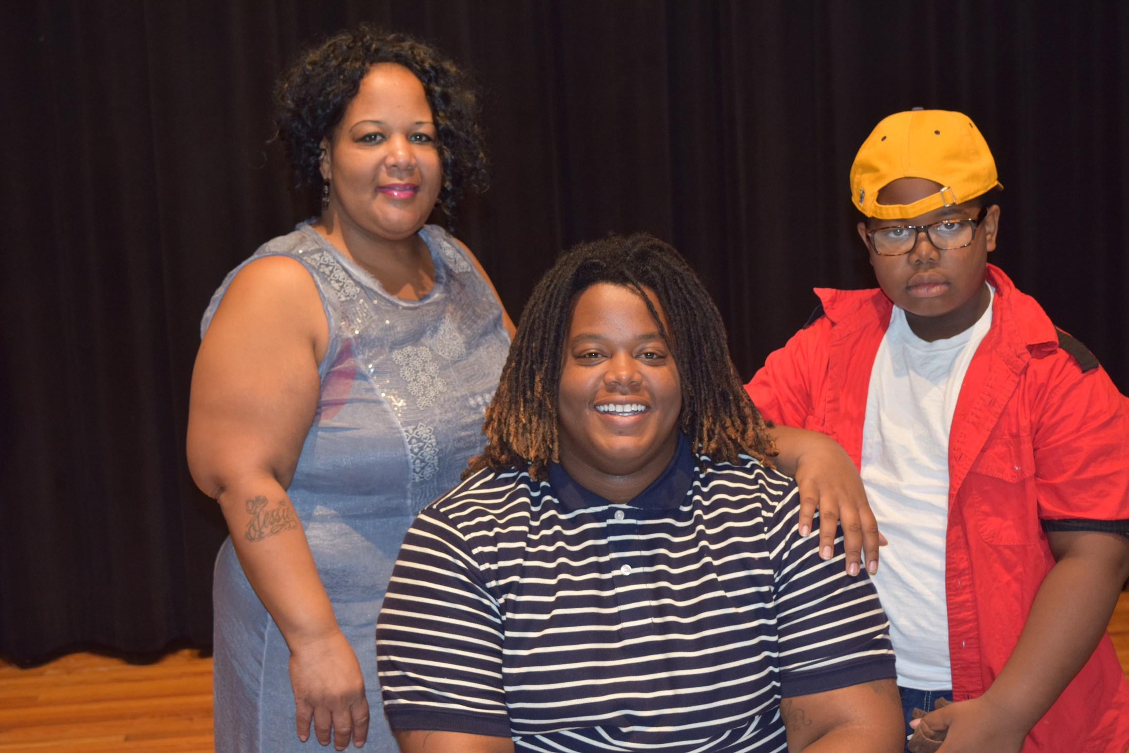 student with parents on signing day