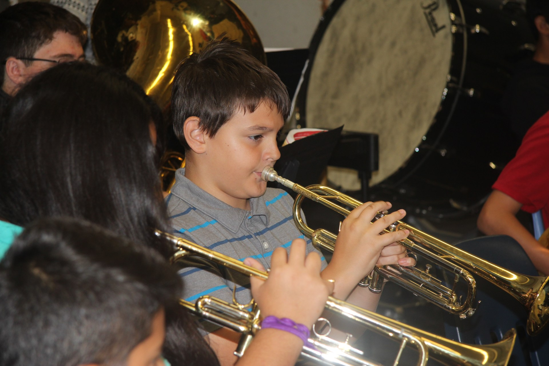Students playing musical instruments in band class