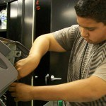 student repairing computer