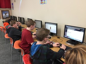 Students work together on computers