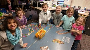 Students count out 100 objects to display.