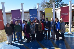 Local Realtors are pictured with Summit students.
