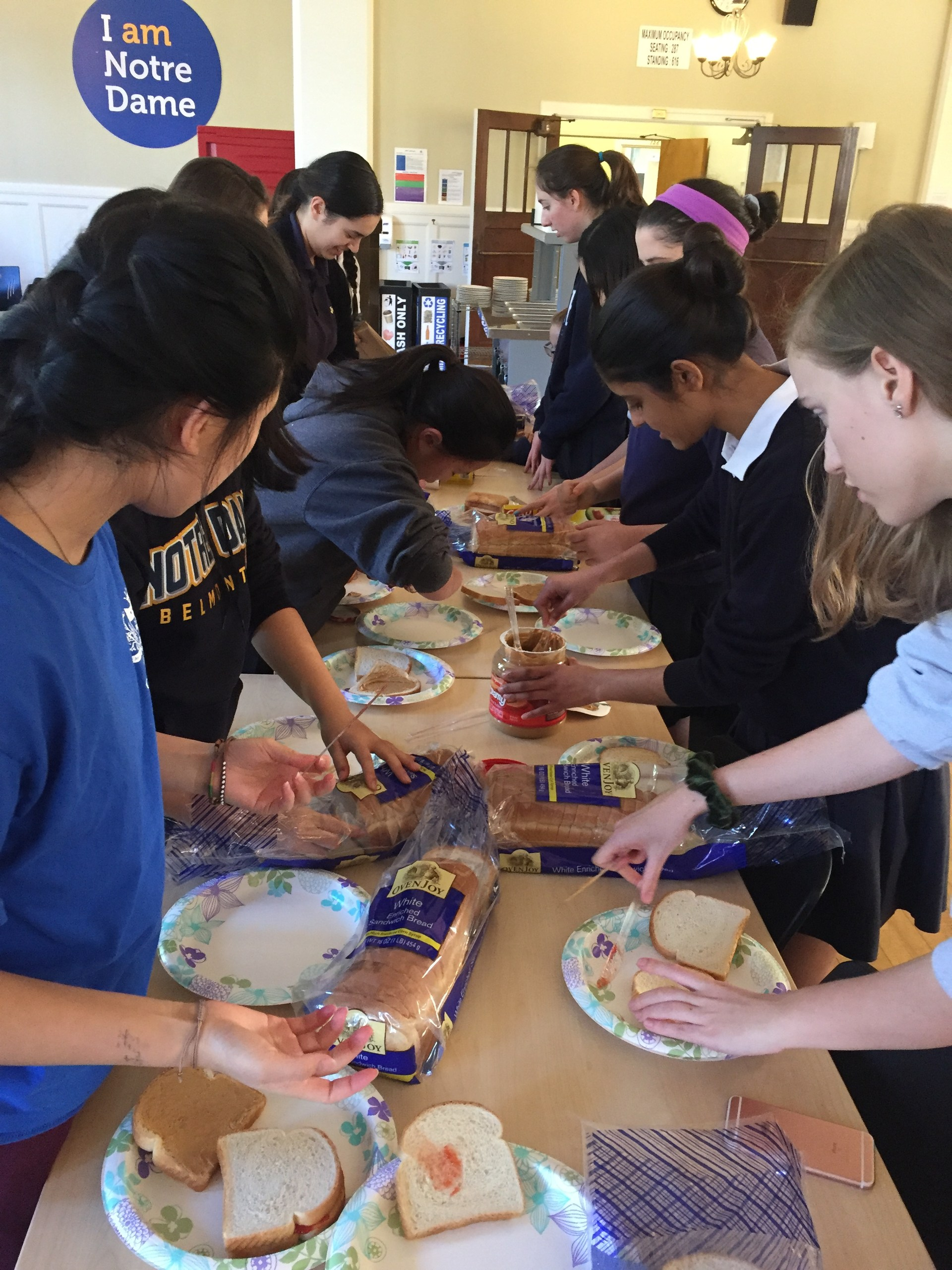 Students creating lunch bags for St. Vincent de Paul