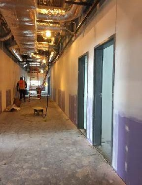 Interior view of hallway with steel framing and drywall