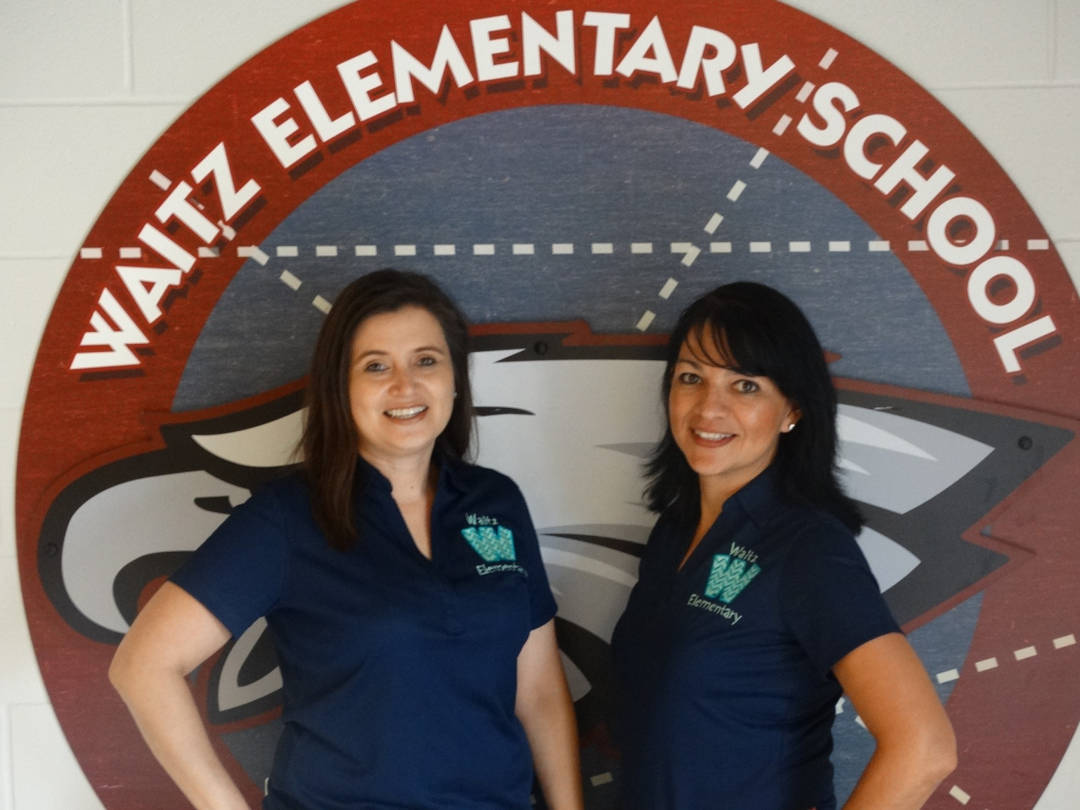 Librarian Mrs. Tanguma and library clerk Mrs. Perez