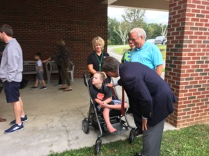 J. Matlock visits with students