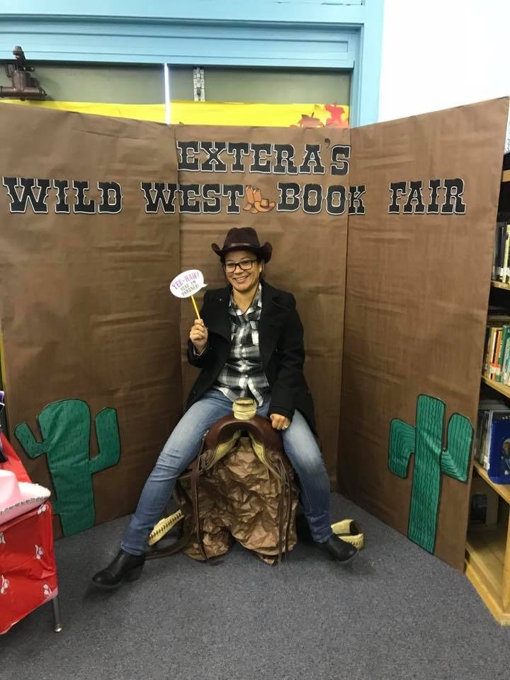 Principal getting ready for book fair