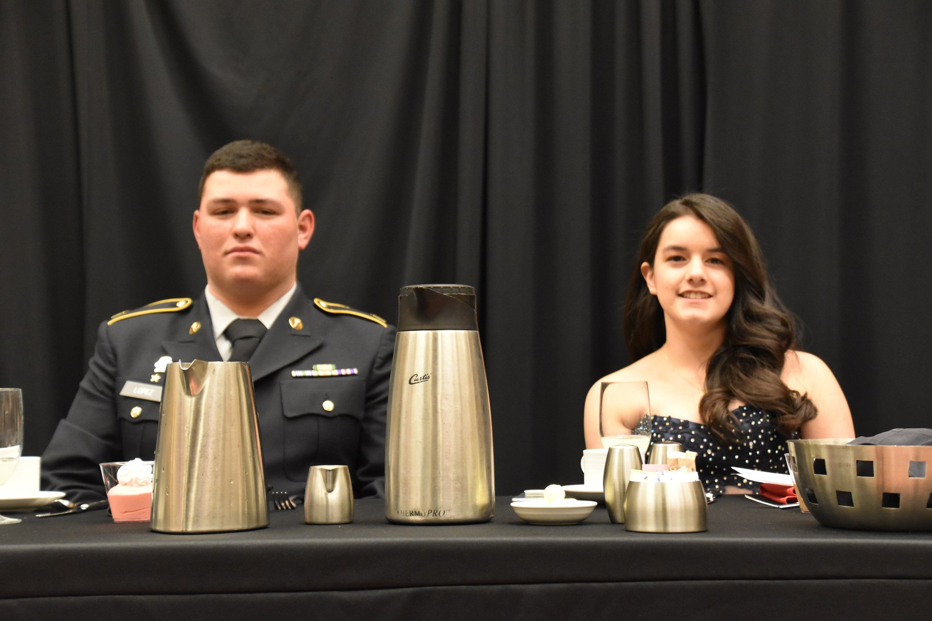 Cadet Sergeant Major Audoro Lopez and Dahlia Vargas at head table.