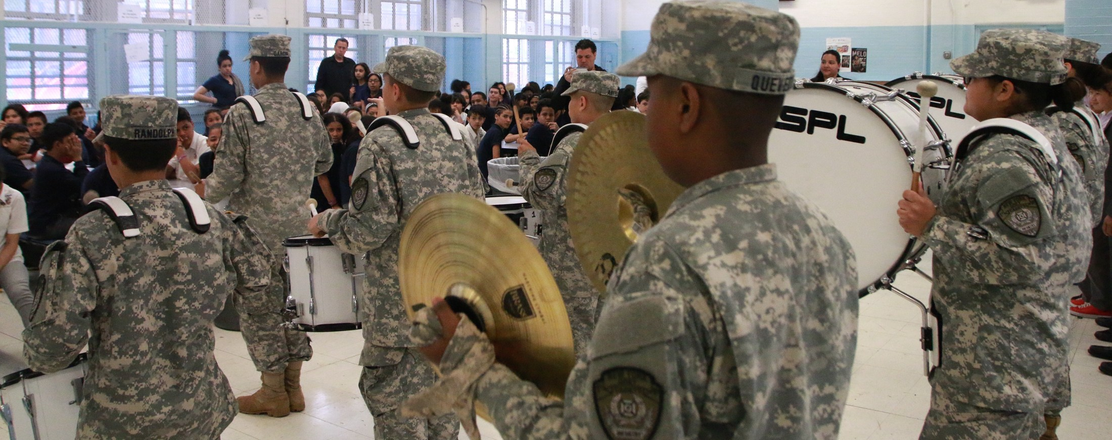 NY Grey Cadets playing instruments in the cafeteria