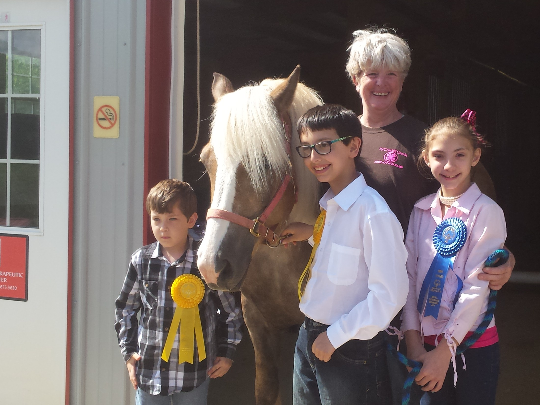 Students participating in the horse therapy.