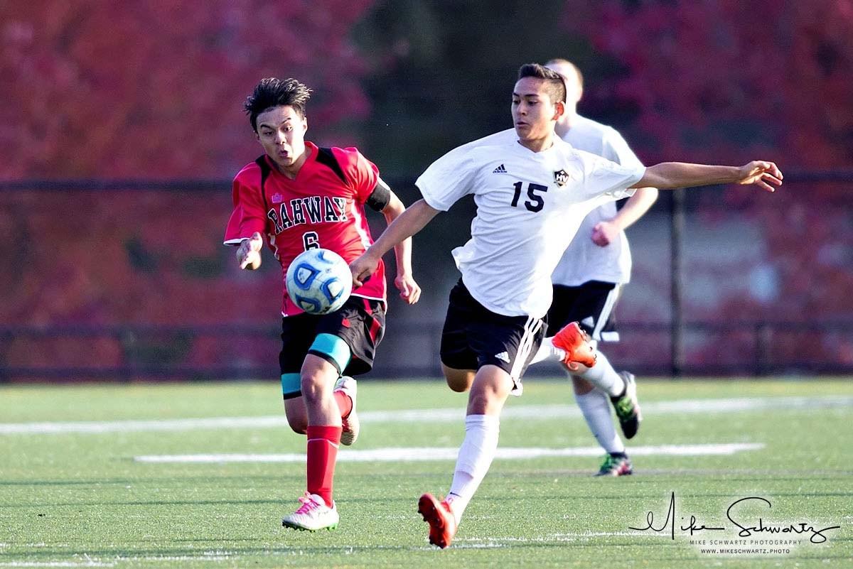CHS boys soccer team player runs after the ball