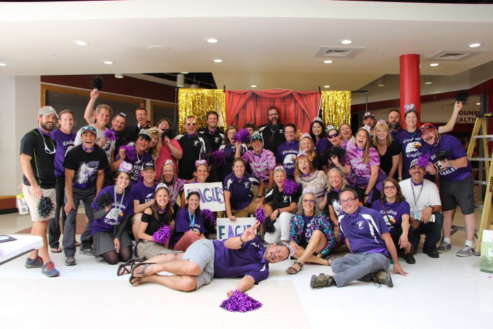 Escalante staff posing with props for convocation