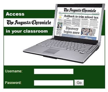 Picture of a laptop displaying an online newspaper