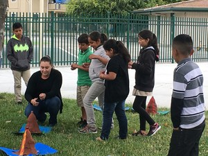 students work with teacher to set off vocalic explosions