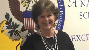A picture of Dr. Cindy Pridgen smiling. She is the principal of Woodland Heights Elementary School.
