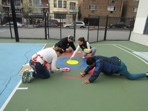 parent volunteers beautifying the playground