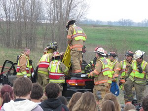 Mock crash reminds students to be safe while driving.
